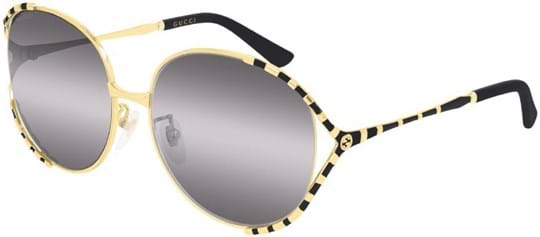 Gucci Women's sunglasses with a frame made of metal in gold and lenses made of plastic in grey